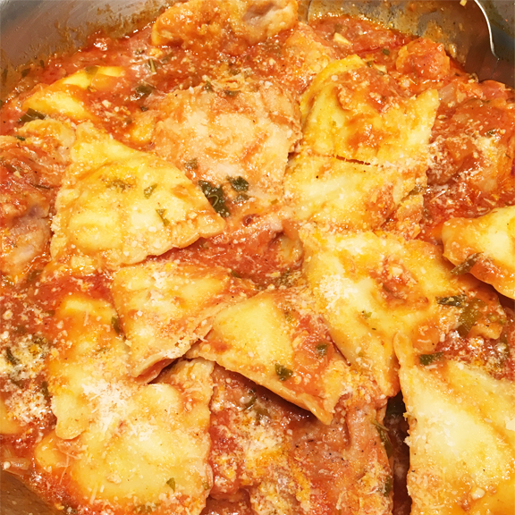 Image of ravioli in a chicken pasta sauce